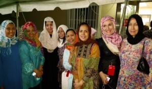 "These are some of the Indonesian-American women that I met at Masjid Al-Hikmah, while filming the field piece. Their garments were so colorful, festive and varied, in both texture and patterns, that I called them ""Butterflies at the mosque."" Their wardrobe offered a totally different insight into Muslim women's fashion. Photo courtesy by Eugene Hyon."